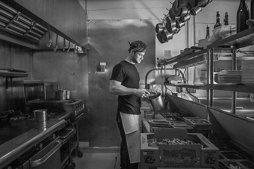 Lead line cook Ryan Raternostro in the kitchen of the Restaurant, Jole, Calistoga, California (© Clark James Mishler)