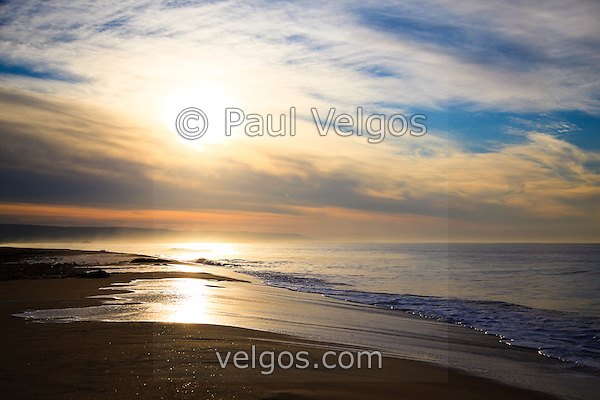 Picture of Newport Beach sunrise along the Pacific Ocean. Taken from Balboa Peninsula Beach in Orange County Southern California. High resolution photo. (Photographer: Paul Velgos)