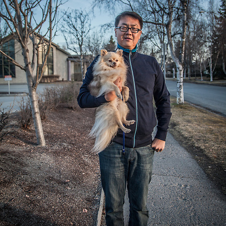Mark Jen and his dog, Kaya, on G Street near 10th Avenue, Anchorage.  mjenalaska@gmail.com (© Clark James Mishler)