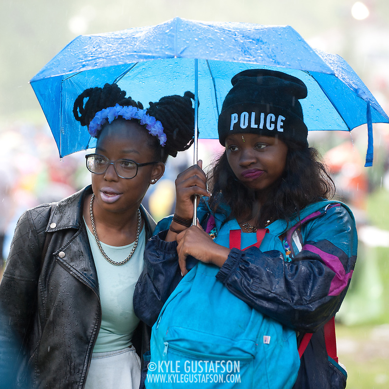 COLUMBIA, MD - May 11th, 2013 - Concert goers stand in the rain at the 2013 Sweetlife Food and Music Festival at Merriweather Post Pavilion in Columbia, MD. Despite plentiful sun early in the day, a powerful storm blew through the venue in the early evening, soaking everything outside the pavilion. (Photo by Kyle Gustafson / For The Washington Post) (Kyle Gustafson/For The Washington Post)