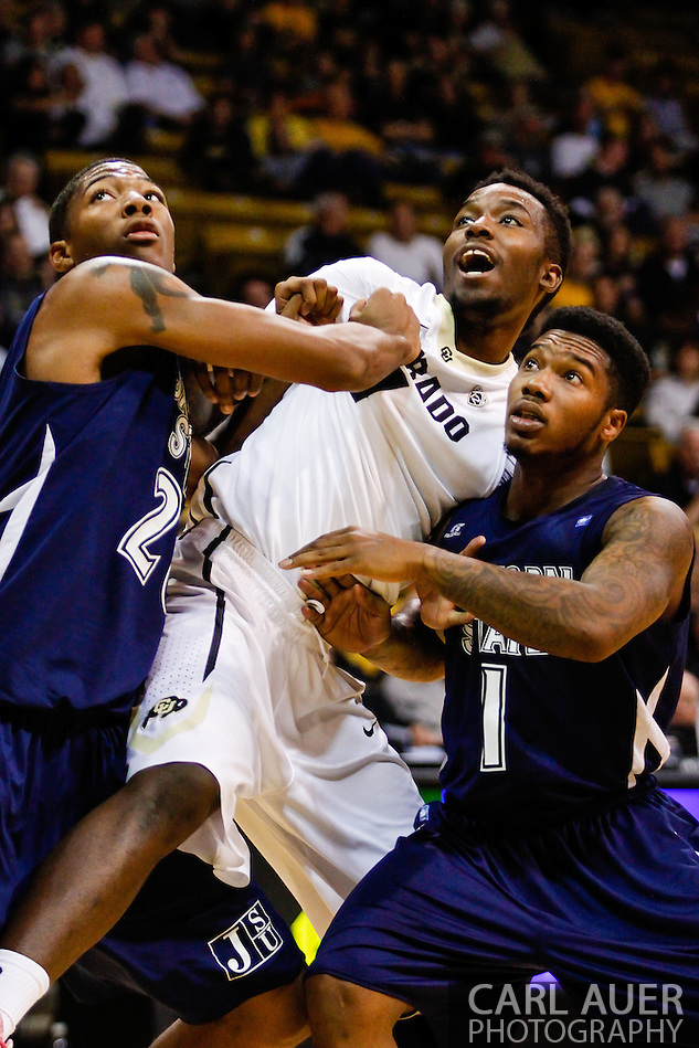 November 16th, 2013:  Colorado Buffaloes redshirt freshman forward Wesley Gordon (1) is held back by a pair Jackson State Tigers players during the second half of the NCAA Basketball game between the Jackson State Tigers and the University of Colorado Buffaloes at the Coors Events Center in Boulder, Colorado (Carl Auer/ZUMAPRESS.com)