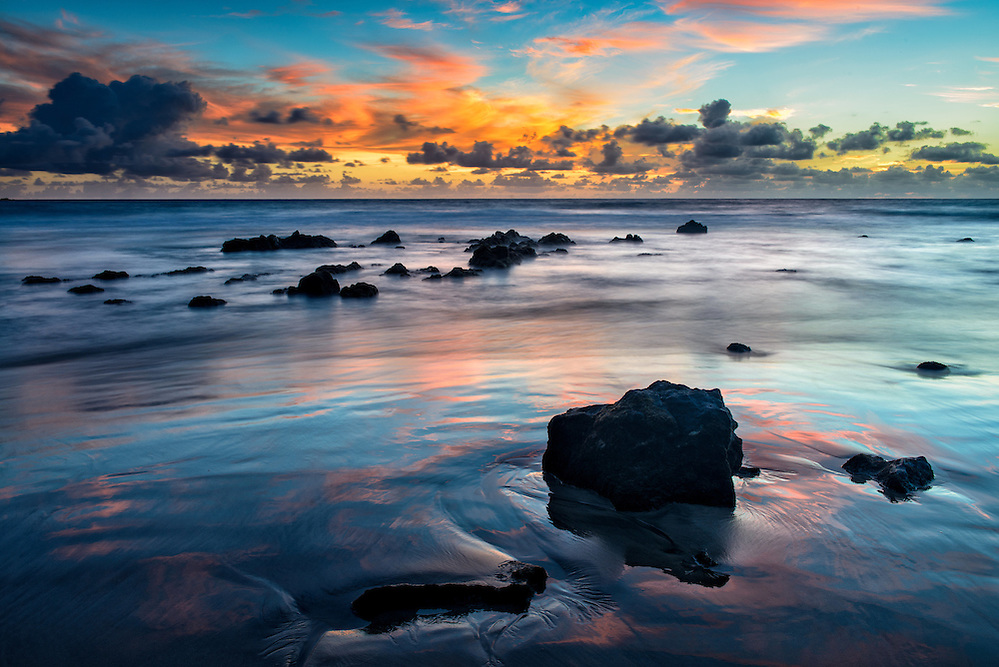 Sky reflecting in the sands of Koki Beach in Hana, Mau'i (Doug Oglesby)