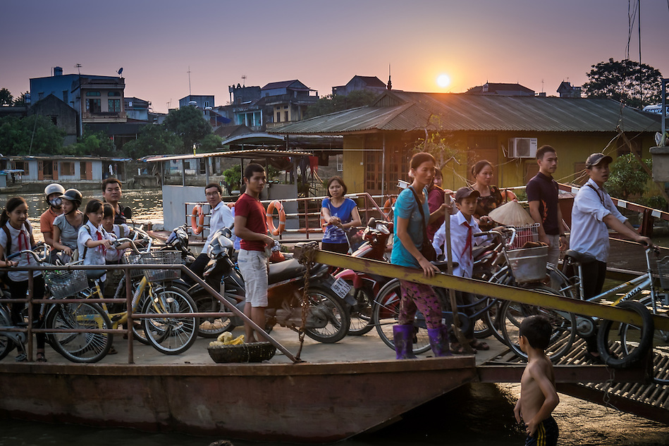 VAN HA, VIETNAM - CIRCA SEPTEMBER 2014: People coming to the Lang Gom Tho Ha via ferry, the village belongs to the Van Ha commune, it is located 50km away from Hanoi in Northern Vietman (Daniel Korzeniewski)