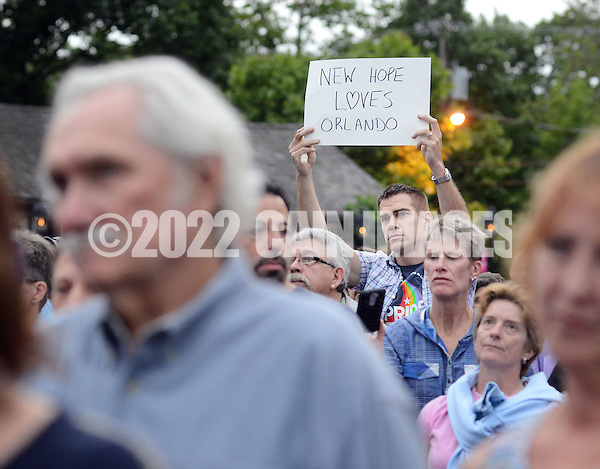 "An unidentified man holds a sign which read, ""New Hope Loves Orlando"" during a candlelight vigil in support of the victims of the Orlando massacre Monday, June 13, 2016 in New Hope, Pennsylvania. (Photo by William Thomas Cain) (William Thomas Cain)"