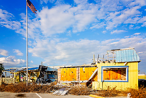 A tattered American flag flies in front of The Fish House restaurant, which was destroyed by Hurricane Michael in 2018, Oct. 8, 2019, in Mexico Beach, Florida. Approximately 85 percent of the structures in town were heavily damaged or destroyed by the hurricane's 160 mph winds. (Photo by Carmen K. Sisson/Cloudybright) (Carmen K. Sisson/Cloudybright)