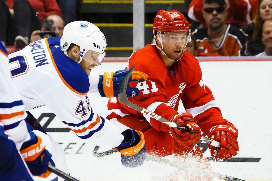 Mar 9, 2015; Detroit, MI, USA; Edmonton Oilers left wing Ryan Hamilton (48) and Detroit Red Wings right wing Luke Glendening (41) in the third period at Joe Louis Arena. Detroit won 5-2. Mandatory Credit: Rick Osentoski-USA TODAY Sports (Rick Osentoski/Rick Osentoski-USA TODAY Sports)