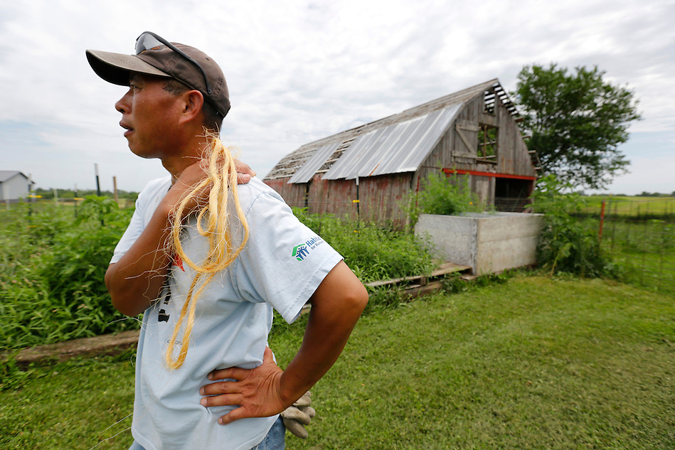 "Farmer Phrakhounmany ""Air"" Philavanh has spent years restoring the farm he bought in 2010 near Milo.  A Laotian immigrant, Philavanh remembers his grandfather's farm in Laos and has always wanted to farm in America.  He is raising cattle and plans to raise duck, a popular food among the Laotian people. (Christopher Gannon/The Register)"