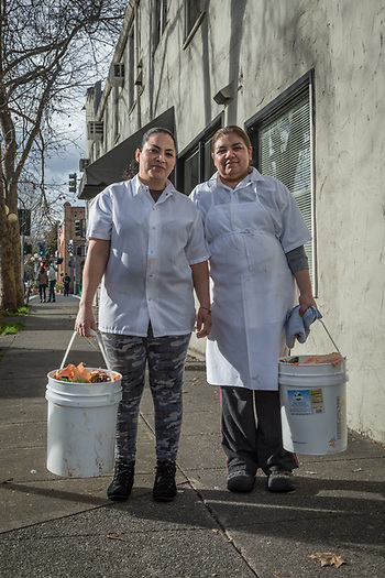 Hydro Grill employees Frances Reyez and Maria Morano carry buckets to the recycling bin in downtown Calistoga (© 2017 Clark James Mishler)