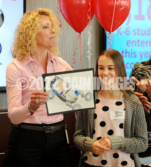 Laura Thompson Barnes (L) introduces Sophia Ponomarenko, who's drawing of The Maserati Leaper won 1st place and the grand prize in the Thompson Organization's Draw the Future Contest Thursday April 16, 2015 at Thompson Toyota in Doylestown, Pennsylvania. A record 1,184 entries from kindergarten to sixth grade were received from students at more than 40 local schools. The grand prize winner will have her drawing featured on a billboard. (Photo by William Thomas Cain/Cain Images) (William Thomas Cain)