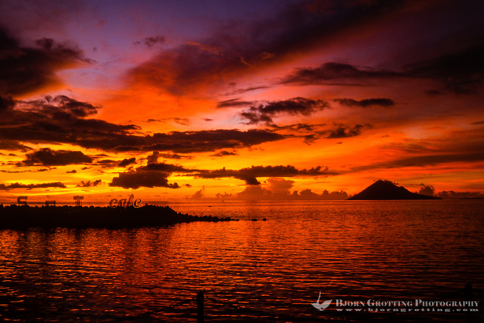 Indonesia, Sulawesi, Manado. A colourful sunset seen from Sunset Cafe. Manado Tua in the background. (Photo Bjorn Grotting)
