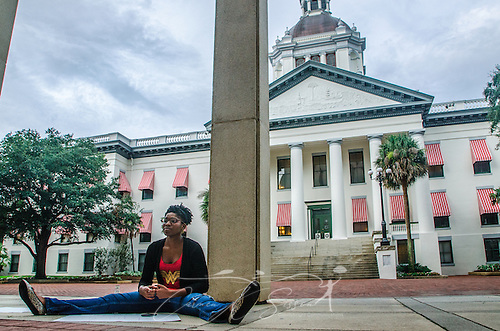 "LaQuinta Alexander, 21, sits outside the Florida state capitol in Tallahassee, Fla., on July 20, 2013, in support of Dream Defenders, a youth-led activist group which sequestered itself within the building July 16, 2013, demanding a special legislative session to address concerns over racial profiling and Florida's ""stand-your-ground"" self-defense law. The group formed in 2012 after the fatal shooting of 17-year-old Trayvon Martin.  (Photo by Carmen K. Sisson/Cloudybright) (Carmen K. Sisson/Cloudybright)"