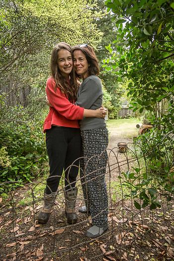Kim Wedlake and her daughter, Sofia, hug outside their home on Easter morning in Calistoga. (Clark James Mishler)