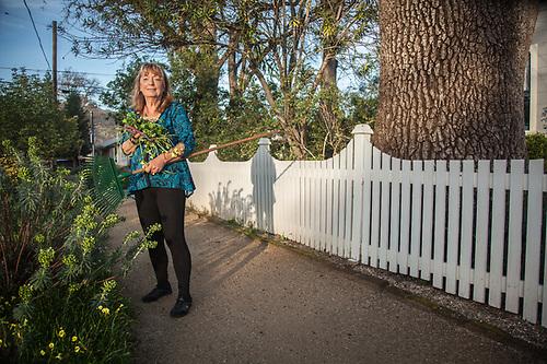 My gardener neighbor, Nanci M. Smith, in front of her house in Calistoga (Clark James Mishler)