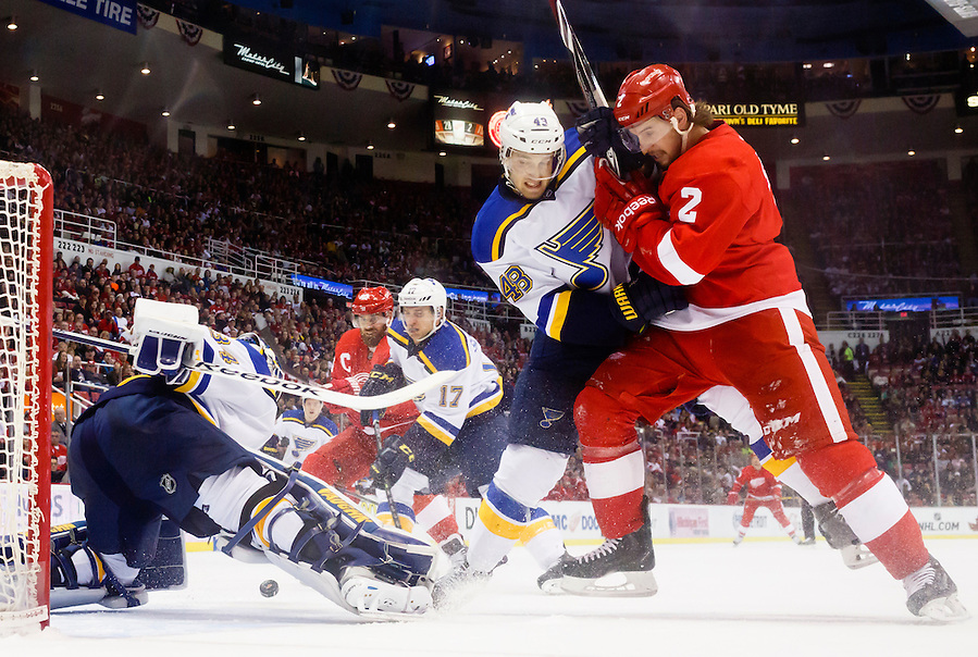 Mar 22, 2015; Detroit, MI, USA; St. Louis Blues goalie Jake Allen (34) makes a save as defenseman Petteri Lindbohm (48) and Detroit Red Wings defenseman Brendan Smith (2) fight for position with in the first period at Joe Louis Arena. Mandatory Credit: Rick Osentoski-USA TODAY Sports (Rick Osentoski/Rick Osentoski-USA TODAY Sports)