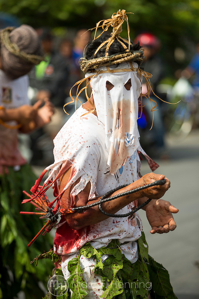 Photo by Marc F. Henning A flagellant whips himself with a flail made of bamboo strips April 18, 2014, during the Penitensya Festival on Good Friday in Mansalay, Oriental Mindoro, Philippines. (MARC F. HENNING/MARC F. HENNING PHOTOGRAPHY)
