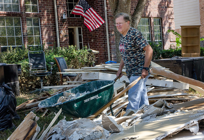 Richard Dick, of Kingsland Baptist Church, removes sheetrock from a flood-damaged home, Sept. 12, 2017, in Katy, Texas. Homeowner Mike Glover's home was flooded when Hurricane Harvey dumped more than 51 inches of rainfall in mid-August. Approximately 70 people died in the U.S. due to the hurricane and flooding. (Photo by Carmen K. Sisson) (Carmen K. Sisson/Cloudybright)