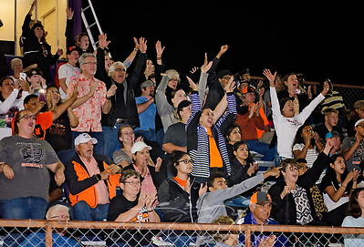 Refugio High School football fans leap to their seats as th team scores, Sept. 29, 2017, in Seguin, Texas. The team lost to Navarro High School 21-17, bringing their record to 2-1. Many of the team members have been sleeping in the team's weight room after their homes were destroyed by Hurricane Harvey in late August. The fans traveled more than two hours to support the Bobcats. (Photo by Carmen K. Sisson) (Carmen K. Sisson/Cloudybright)
