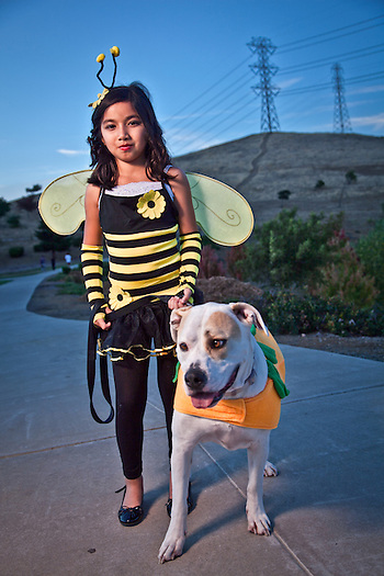 Nine year old, Evelyn DeLarea and her dog Bailey on Halloween evening, Oak Hills, Pittsburg, CA (Clark James Mishler)