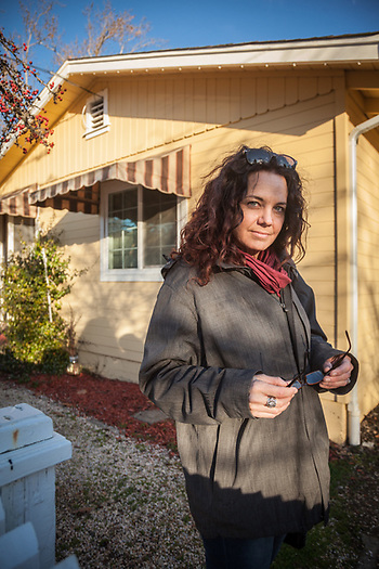 Danville bartender, Katie Wright, in front of her home on Third Avenue in Calistoga.   katieandcoz@yahoo.com (Clark James Mishler)