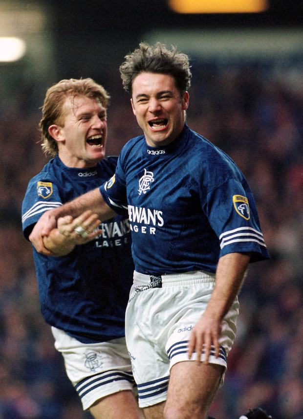 1996, ALLY MCCOIST CELEBRATES SCORING A GOAL WITH TEAM-MATE STUART MCCALL, ROB CASEY PHOTOGRAPHY. (ROB CASEY/ROB CASEY PHOTOGRAPHY)