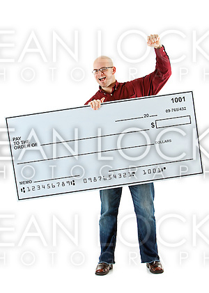 Isolated on white background series of a Caucasian man with an oversized bank check. (Sean Locke)