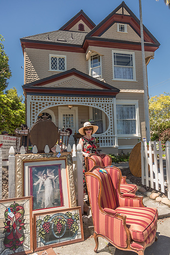 Diana sells vintage items in front of her home during the Petaluma Antique Fair. (Clark James Mishler)