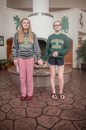 "Sisters Hannah (17) and Emma (15) in the lobby of the Best Western Kiva Inn in Fort Collins, CO.  ""We'er here with our parents to check out the University.""  ""And, what do you think?""  ""We love it.""  nsolpinski@yahoo.com  (Nancy, Mom) (© Clark James Mishler)"