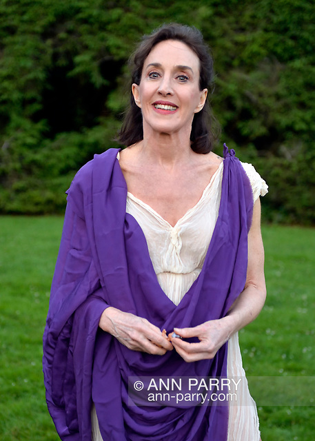 """""""Old Westbury, New York, U.S. - June 21, 2014 - Lori Belilove & The Isadora Duncan Dance Company dances modern dance in Greek tunics throughout the gardens during the Midsummer Night event at the historic Long Island Gold Coast estate of Old Westbury Gardens. Ms. Belilove is wearing a Greek white tunic and purple over-scarf. (© 2014 Ann Parry/AnnParry.com)"""