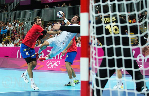 08 AUG 2012 - LONDON, GBR - Nikola Karabatic (FRA) of France (centre) shoots during the men's London 2012 Olympic Games quarter final match against Spain at the Basketball Arena in the Olympic Park, in Stratford, London, Great Britain (PHOTO (C) 2012 NIGEL FARROW) (NIGEL FARROW/(C) 2012 NIGEL FARROW)