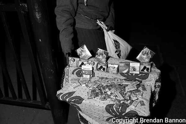"""Mama Condom"" sells condoms, gum, candy and cigarettes outside a night club in Nairobi's city center. (Brendan Bannon)"
