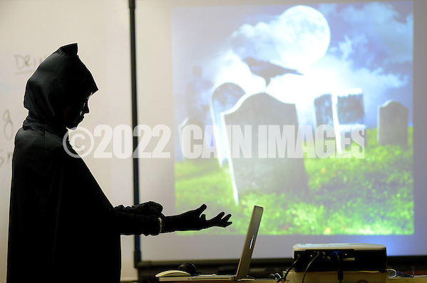 Kyle Tevlin dresses as the grim reaper to start her fun funeral planning class Wednesday, October 19, 2016 at Keith Valley Middle School in Horsham, Pennsylvania. Devlin runs a Devon-based, personal-planning business that finds creative ways to hold funerals and memorials at places that meant something to the deceased, whether that's a beach or a bar. (WILLIAM THOMAS CAIN / For The Philadelphia Inquirer) (William Thomas Cain/Cain Images)
