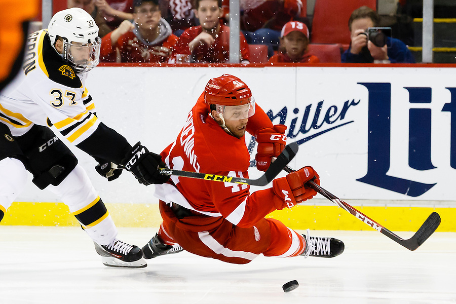 Apr 2, 2015; Detroit, MI, USA; Boston Bruins center Patrice Bergeron (37) trips Detroit Red Wings right wing Luke Glendening (41) in the third period at Joe Louis Arena. Boston won 3-2. Mandatory Credit: Rick Osentoski-USA TODAY Sports (Rick Osentoski/Rick Osentoski-USA TODAY Sports)