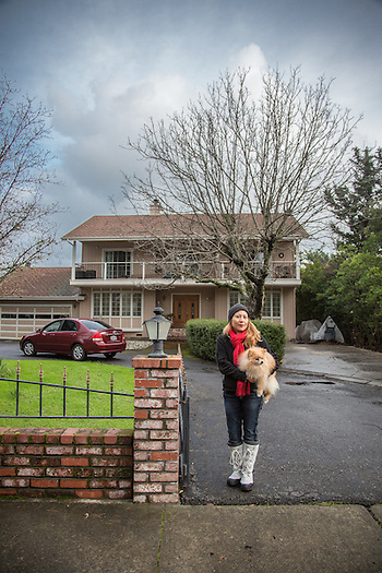 "Buddy and I moved into this house about a year ago...I have three roommates."" Massage/Hypno Theropist Liza Xavier stands with her dog, Buddy, in front of her home on a blustery afternoon in Calistoga. (Clark James Mishler)"