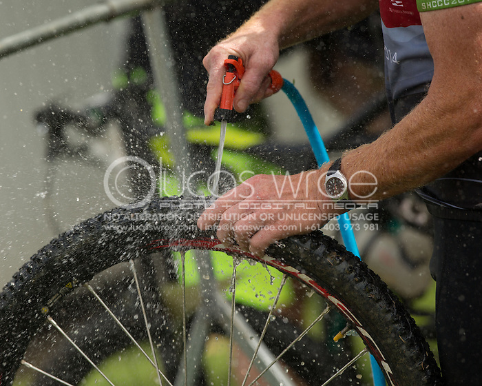 Competitors wash their bikes post race, June 1, 2014 - MOUNTAIN BIKE : RRR Mountain Bike Challenge, Cairns Airport Adventure Festival, Four Mile Beach, Port Douglas, Queensland, Australia. Credit: Lucas Wroe (Lucas Wroe)