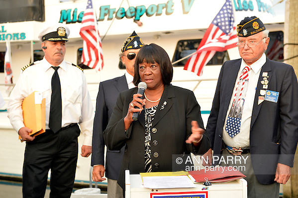 Freeport, New York, USA. September 10, 2014. Town of Hempstead Councilwoman DOROTHY GOOSBY speaks at a dockside remembrance ceremony in honor of victims of the terrorist attacks of September 11 2001, at the boat Miss Freeport V, on Freeport's Nautical Mile. Further ceremonies were held on board the vessel, which sailed from the Woodcleft Canal on the South Shore of Long Island, on the eve of the 13th Anniversary of the 9/11 attacks. (Ann Parry/Ann Parry, ann-parry.com)