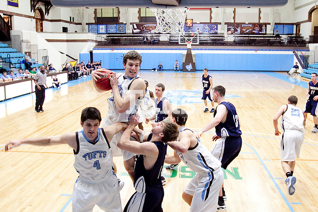 20110210 - Medford, Mass. - Tufts forward Alex Orchowski (A12) pulls down a rebound in Tufts 69-47 win over Gordon at Cousens Gymnasium on Feb. 10, 2011....(Kelvin Ma/Tufts University) (Kelvin Ma/Tufts University)