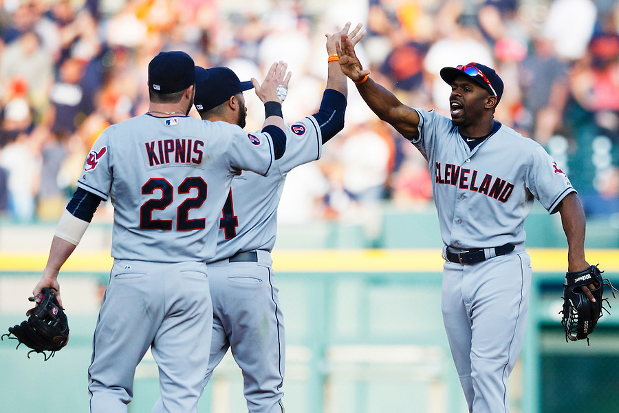 Jun 13, 2015; Detroit, MI, USA; Cleveland Indians second baseman Jason Kipnis (22) shortstop Mike Aviles (4) and center fielder Michael Bourn (24) celebrate after the game against the Detroit Tigers at Comerica Park. Cleveland won 5-4. Mandatory Credit: Rick Osentoski-USA TODAY Sports (Rick Osentoski/Rick Osentoski-USA TODAY Sports)