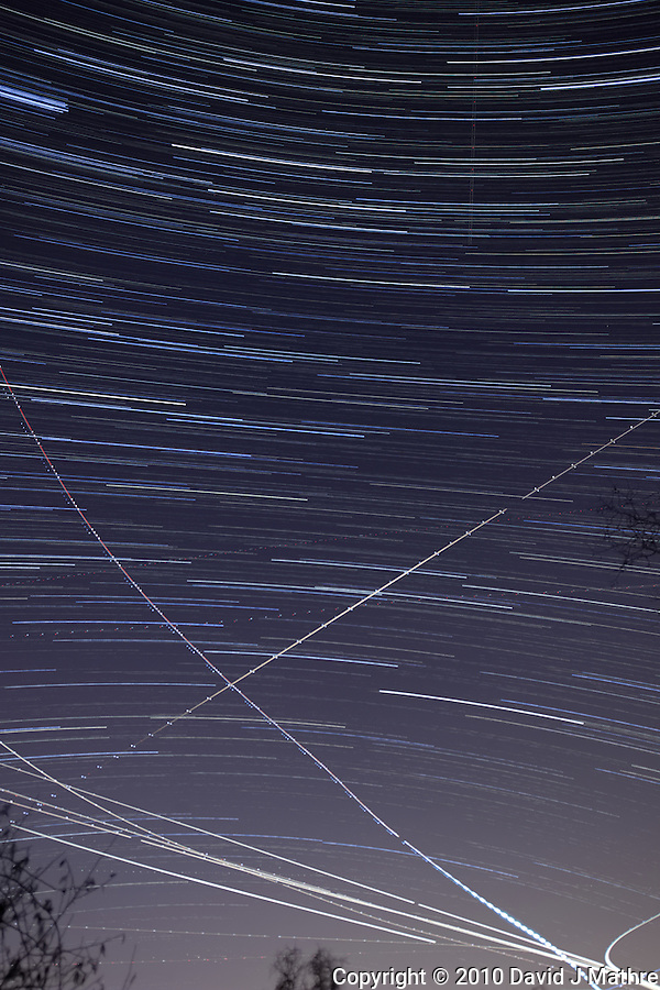 Late Fall Night Sky Image of Star and Jet Trails. Image taken with a Nikon D3x and 24 mm f/3.5 PC-E lens (ISO 400, f/4.0, 30 sec). Composite of 120 images over 1 hour combined with Startrails program. Hour 1. (David J Mathre)