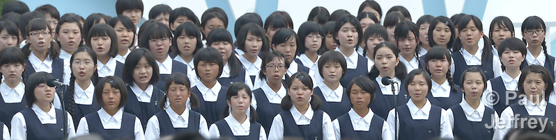 Part of a children's choir that sang during a memorial ceremony in Nagasaki, Japan, on August 9, 2015, the 70th anniversary of the day the United States dropped an atomic bomb on the city. Participants in the ceremony included members of an ecumenical group of pilgrims from the World Council of Churches who each came to Japan to see for themselves the results of the bombings 70 years ago, to listen to survivors and local church leaders, and to recommit themselves to new forms of advocacy for a world free of nuclear weapons. (Paul Jeffrey)