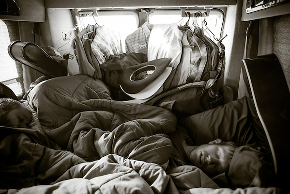 As a fellow rider takes the wheel, Jacobs Crawley naps in the back of his van somewhere in California. (Darren Carroll)
