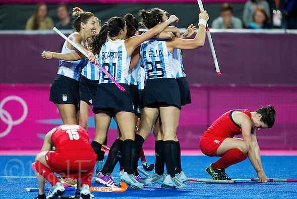 08 AUG 2012 - LONDON, GBR - Argentinian (ARG) players celebrate winning the London 2012 Olympic Games women's semi final match against Great Britain at the Riverbank Arena in the Olympic Park, Stratford, London, Great Britain (PHOTO (C) 2012 NIGEL FARROW) (NIGEL FARROW/(C) 2012 NIGEL FARROW)