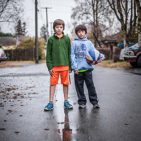 "Buddies Paul Melchert and Reiveri Flanery in the alley near 13th Ave. between G and H Streets, Anchorage.  ""We're happy it stopped raining before it got dark.""  -Paul Melchert        (Patty @ 223-3184)  patty99501@gmail.com (© Clark James Mishler)"