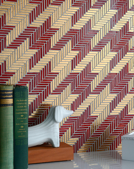Houndstooth, a hand cut glass mosaic shown in Ruby and gold glass, is part of the Houndstooth Collection by Sara Baldwin for New Ravenna Mosaics. Dachshund bookends are from Jonathan Adler. (New Ravenna Mosaics)