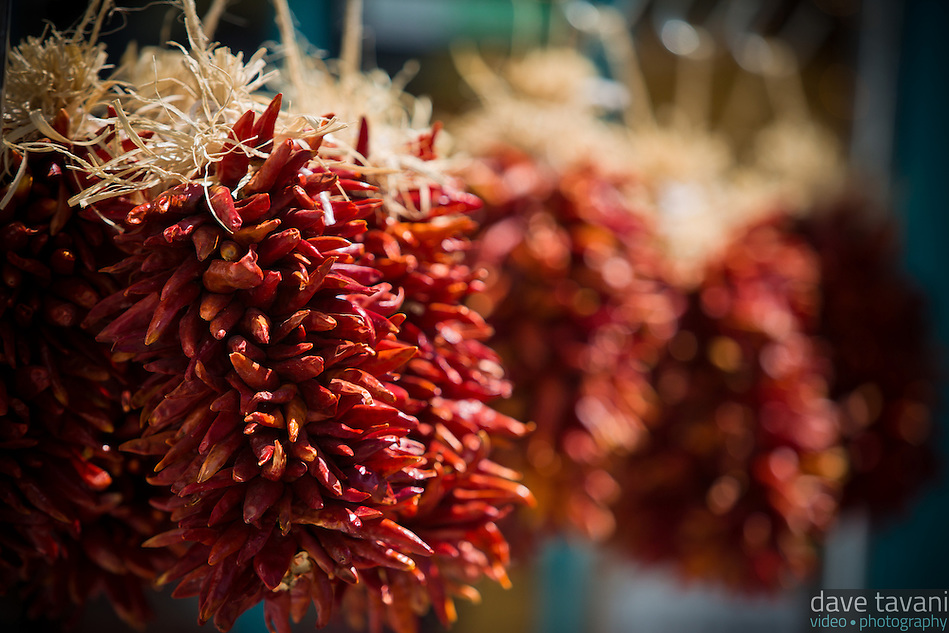 Red chilis grown in the Rio Grande Valley hang outside a store in Old Town Albuquerque. (Dave Tavani)