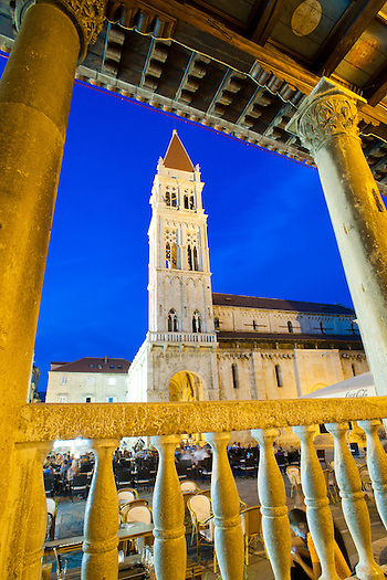 Photo of St Lawrence Cathedral at night, Trogir, Dalmatian Coast, Croatia. This photo shows St Lawrence Cathedral at night in the main square of Trogir. Trogir Old Town is a UNESCO World Heritage Site with sites a plenty. For its impressive spire and stunning location in the centre of a large cobbled square, St Lawrence Cathedral is easily the most iconic and famous.