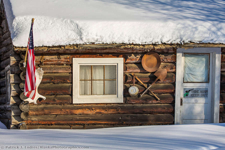 Rustic mining cabin in the winter in the small community of Livengood, Alaska. (Patrick J Endres / AlaskaPhotoGraphics.com)
