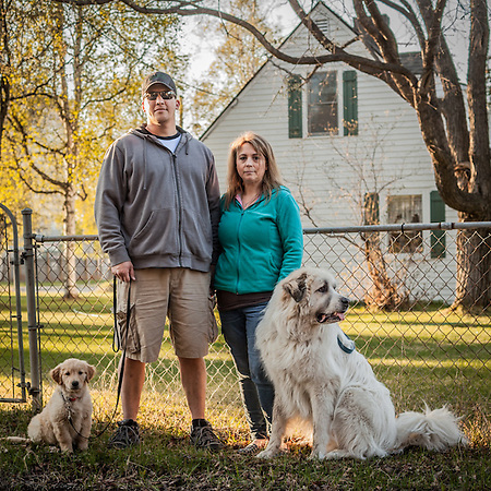 "Neighbors Damian LaTocha and Trena Sylvia with their dogs Maggie and Russell in Anchorage's South Addition Neigborhood  ""I moved to Anchorage after sixteen years in Fairbanks…there's more to do here.""  -Trena Sylvia  trenals@ymail.com (© Clark James Mishler)"
