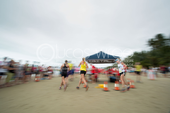 Age Group Competitors at the run turn-around, June 1, 2014 - TRIATHLON : Coral Coast 5150 Triathlon, Cairns Airport Adventure Festival, Four Mile Beach, Port Douglas, Queensland, Australia. Credit: Lucas Wroe (Lucas Wroe)