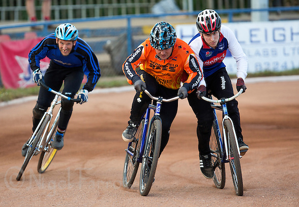 13 SEP 2014 - IPSWICH, GBR - Chris Jenkes (centre) of Wednesfield Aces and Charlie Rumbold (right) from Ipswich clash during a heat of the 2014 British Open Club Cycle Speedway Championship final at Whitton Sports & Community Centre in Ipswich, Great Britain (PHOTO COPYRIGHT © 2014 NIGEL FARROW, ALL RIGHTS RESERVED) (NIGEL FARROW/COPYRIGHT © 2014 NIGEL FARROW : www.nigelfarrow.com)