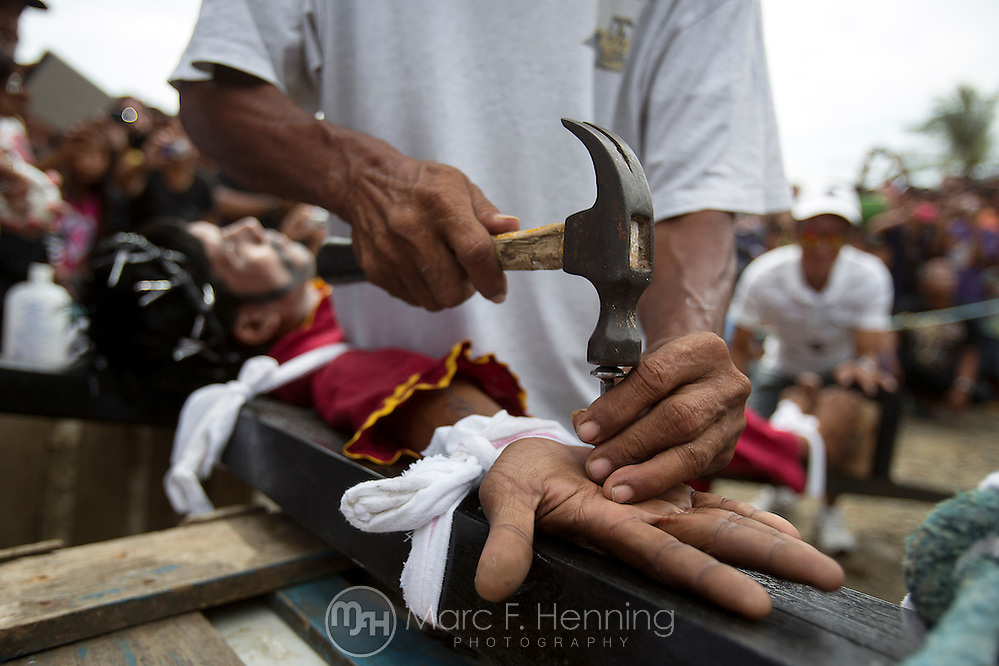 Photo by Marc F. Henning A Filipino's hands are nailed to a cross April 18, 2014, during one of two reenactments of the crucifixion of Jesus Christ on Good Friday in Mansalay, Oriental Mindoro, Philippines. The crucifixions were the first ever to be reenacted in Mansalay for Good Friday. (MARC F. HENNING/MARC F. HENNING PHOTOGRAPHY)